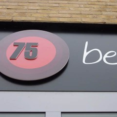 Shop Signage. Floating Circle with cut vinyl text, Hampton.