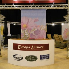 Exhibition Graphics. Desk Graphic with Hanging Signage