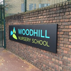 Wall mounted school signage, South East and London